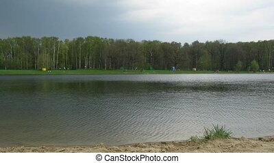 Over a pond the cloud, spring day floats - Over a pond the...