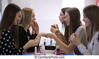 Close up image of young females preparing in model school....