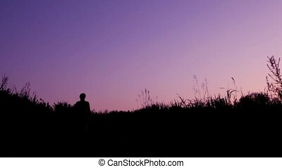 silhouette of man with backpack against sky - silhouette of...