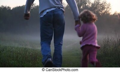 girl with daddy go on footpath - girl with daddy keeping for...