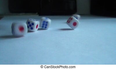 Falling five dice on a white