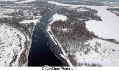 Aerial View. Flight over the beautiful winter river and...