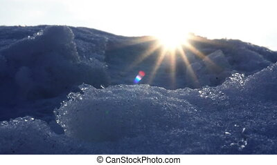close-up of snowing cold mountains with bright warm rays -...