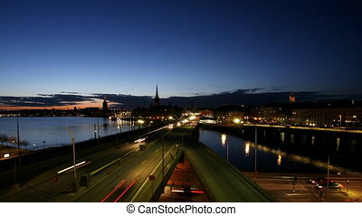 Traffic on Freeway in Sweden - Old town in Stockholm at...