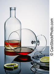 Glasswares winh the alcohol remains, pieces and a peel of a...