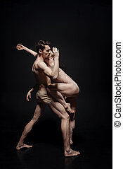 Innovational dance couple taking part in the art performance