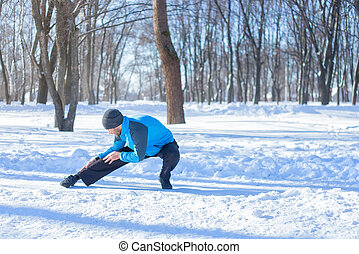 runner doing stretching exercise - Athletic runner...