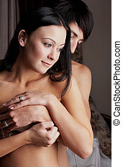 Intimate young lovers - Young adult Caucasian couple in...