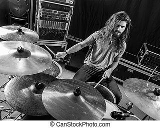 Drummer playing his drum set