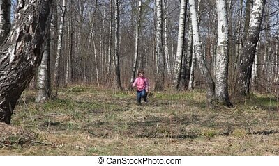 girl runs to camera in spring forest - cute little girl runs...