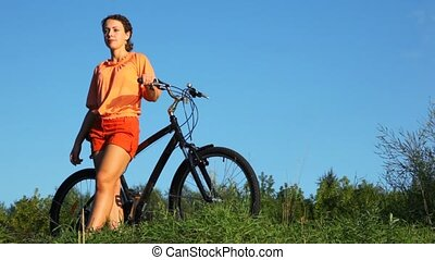 woman with bicycle in summer field - beautiful woman with...