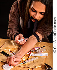 Heroin needle in addict narcotic woman's hand . Junkie...