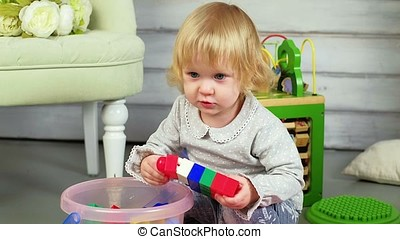 girl playing with toys - Cute funny preschooler little girl...