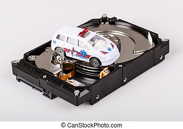 ambulance car on harddrive or hdd - data rescue concept -...