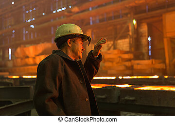 Worker of a metallurgical factory.