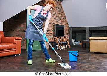 cleaning floor with mop - female cleaner with mop cleaning...