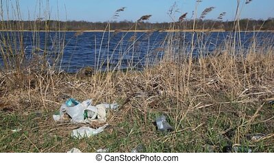household rubbish on bank of river - household rubbish on...