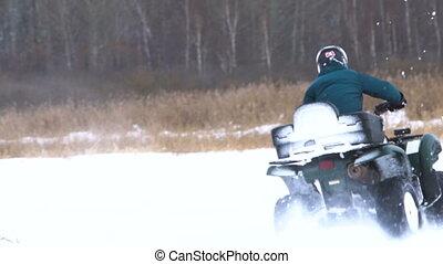 ATV race in the winter season. - ATV race on the snow. Rider...