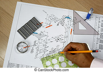 Draftsman at work with his tools design plan and...