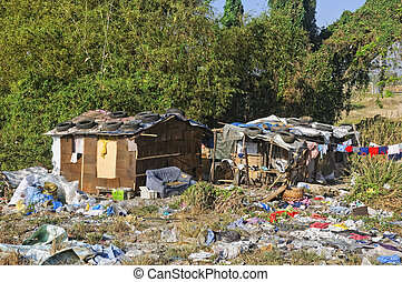 Shanties of illegal settlers in a garbage dump