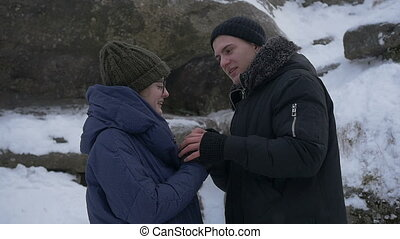 Frozen couple in love - The guy and the girl warm each...
