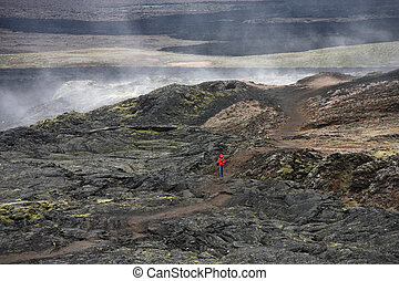 Krafla - Lonely tourist on lava field in Krafla volcanic...