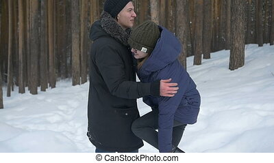 A girl and a boy lying in the snow, play with snow. Winter,...