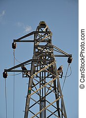 Power line tower on blue sky - A power line tower in...