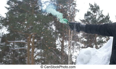 A couple of lit a smoke bomb - The guy with the girl lit a...