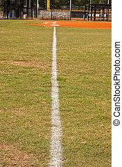 Foul Line on Baseball Field - A white chalk foul line down...