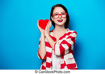 smiling woman with heart shape box - portrait of the...