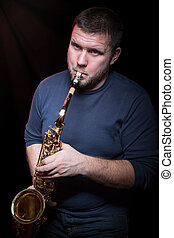 Bearded man playing the saxophone