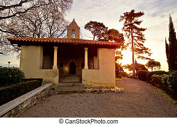 Stone chappel and church in Lovran at sunset, Kvarner bay,...