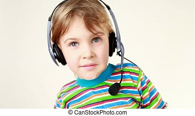 Girl in headset swings from side to side and listens music -...