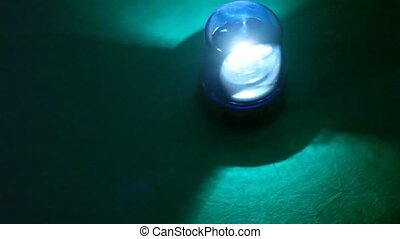 flasher rotates rapidly in dark and illuminates floor...