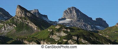Summer scene on mount Titlis - Green meadows, mountains and...