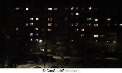 Time lapse of High-density apartment block at night