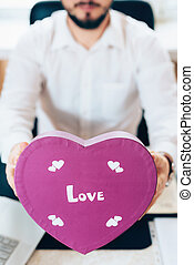 Business man prepared a gift in the form of heart - Business...