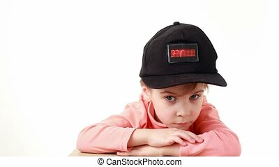 girl in cap with inscription, I love you, on red LED display...