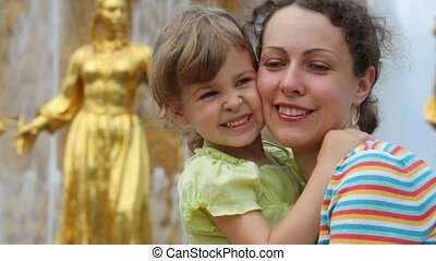 Mother and daughter near Fountain Friendship of Peoples -...