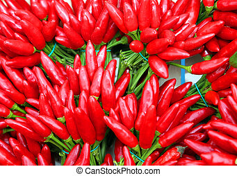 small bouquets of red hot chillies on sale at the...