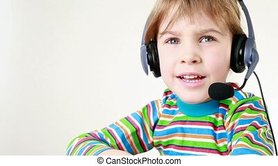 Girl in headset moves her hands and sings - Girl in headset...