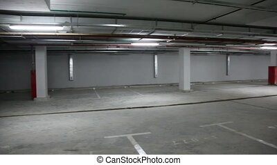 Panorama of empty underground parking, from left to the...