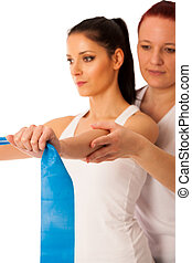 Physiotherapy - therapist doing arm strenghteninh excercises with a patient to recover strenght after injury