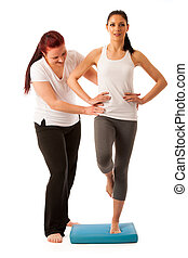 Physiotherapy - therapist doing   excercises for improving coordination and stability with a patient to recover  after injury isolated