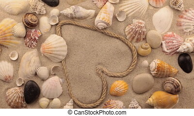 Rotation of the heart made of rope and seashells, stones.
