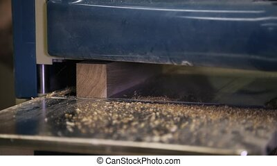 Wood processing by using an industrial tool. Sanding a bar.....
