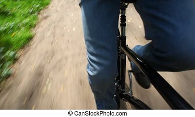 legs of man riding bicycle