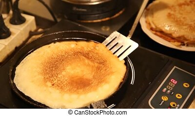 blin baked on frying pan - close up blin baked on frying pan...