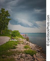 Rocky Shore Cloud Scape - Storm clouds over Detroit River...